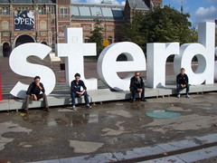 Steven Stauffer, Colten New, Greyson Dructor, and Robert Alderfer sit in front of the Amsterdam sign.