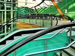 abstraction in green (Harry Halibut) Tags: blue orange green sunshine stairs shadows lift steel elevator transport handrail inside escalators stainless allrightsreserved interchange internal barnsley colourbysoftwarelaziness barnsley081107039 andrewpettigrew