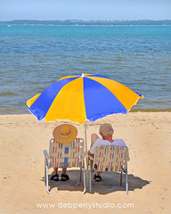 Couple at the beach (Deb Perry Studio) Tags: summer vacation people woman lake man beach water hat umbrella relax bay sand couple married chairs michigan tan relaxing hats elderly shade traversecity elders retired tanning seniors beachchairs sandybeach manandwoman marriedcouple lawnchairs beachumbrella traversecitymichigan seniorcouple oldermarriedcouple traversecitybeach seniorsonbeach traversecitystateparkbeach senioronbeach