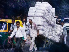Carrying 100 Bags of Grain in Delhi (Stuck in Customs) Tags: pictures poverty panorama india lines work photography nikon asia shoot day photographer shot angle photos delhi details 911 poor d2x perspective images busy help edge future pro hungry portfolio capture population heavy hardwork hdr famine developingcountries thirdworld highquality stuckincustoms developedcountries treyratcliff stucktextures