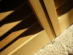 put away... (peppakoka) Tags: door wood shadow sunlight closet carpet