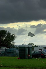 more rain coming (lovestruck.) Tags: summer england storm field rain festival clouds dark flag windy saulcanalfestival