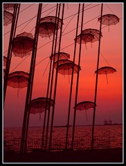 umbrellas of Thessaloniki Greece (maios) Tags: travel sunset red sky sculpture sun color art water metal port umbrella greek design boat photo europa europe flickr mediterranean ship photographer hellas olympus greece macedonia thessaloniki fotografia umbrellas salonica manikis maios iosif  supershot  heliography     mywinners abigfave zogolopoulos    platinumphoto ultimateshot  ysplix theunforgettablepictures  goldstaraward      damniwishidtakenthat      iosifmanikis