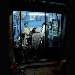 ♪  Shave and a haircut, 2 Rupees   ♫ (Rick Elkins) Tags: light india men night dark bravo candid streetphotography business barbershop shaving shave handheld karnataka mysore fpg mywinners artlibre platinumphoto anawesomeshot aplusphoto goldenphotographer rickelkins