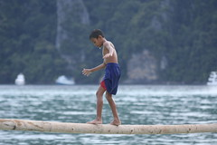 Thai Balancing Skills (Miss Tanith) Tags: ocean wood blue boy sea playing pee boys water kids swimming swim children asian thailand climb wooden kid high log asia child play phi phiphi lads pole climbing ko thai lad droplet acrobat p balance shorts erika koh balancing balanced peeing pp tanith andaman peepee erikatanith