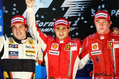 The podium (L to R): Fernando Alonso (ESP) Renault, second; Felipe Massa (BRA) Ferrari, race winner; Kimi Raikkonen (FIN) Ferrari third.Formula One World Championship, Rd 18, Brazilian Grand Prix, Race, Interlagos, Sao Paulo, Brazil, Sunday 2 November 200