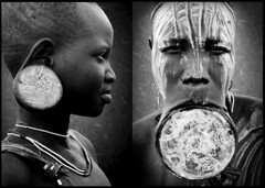 Daughter and mother - Mursi Ethiopia (Eric Lafforgue) Tags: africa wood woman girl artistic dam african plate tribal ring ornament clay ear lip bodypainting ethiopia tribe ethnic rite barrage bodymodification tribo indigenous labret adornment pigments indigenouspeople tribu omo eastafrica thiopien etiopia ethiopie etiopa 3720 3745 tribalgirl lafforgue  etiopija ethnie ethiopi  lipplug lipplate etiopien etipia  etiyopya  southethiopia nomadicpeople   tribalgirls    salinicostruttori    plateaulabial gibeiiidam gibe3dam bienvenuedansmatribu peoplesoftheomovalley lipdisclipplate piercedhole piercedlipornament