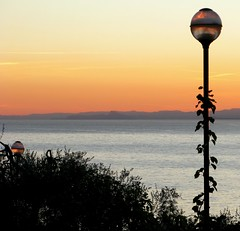sunset light - luce al tramonto (chpaola) Tags: pink blue sky italy black mountains green nature water lamp leaves yellow landscape lago garda purple explore unset lagodigarda gardasee blueribbonwinner bej abigfave ysplix naturewatcher goldstaraward ilovemypics