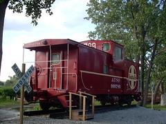 Preserved 1981 vintage Atchinson, Topeka & Santa Fe wide vision caboose. The Santa Fe Prairie nature preserve. Hodgkins Illinois. July 2007.