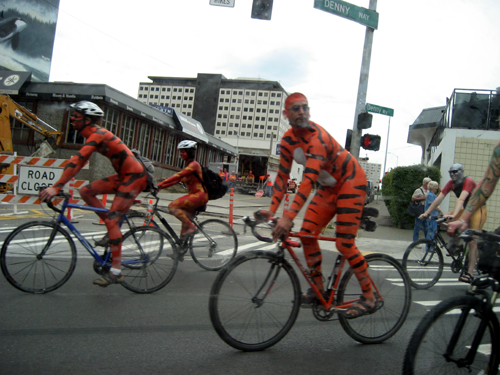 Bike-riding naked dudes painted like tigers