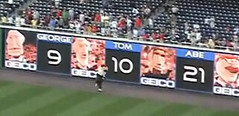 Washington Nationals presidents race standings on the outfield wall during the presidents race at Nationals Park