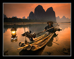 Timeless by Michael Anderson (AndersonImages) Tags: china travel sunset reflection bird lamp sunrise river landscape li michael boat fishing fisherman bravo asia antique traditional culture bamboo hasselblad explore anderson oil romantic medium format cormorant raft lantern cultural dreamcatcher yangshou guanxi xingping h2d outstandingshots flickrsbest bestshotoftheday infinestyle bestofbratanesque artinoneshot whereintheworldiswally flickrsfinestimages1