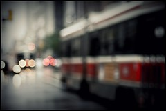 Bokeh and the Rocket (Js) Tags: street red toronto cars rain lights raw nef bokeh ttc 85mm streetcar vignette 85mmf18d hbw
