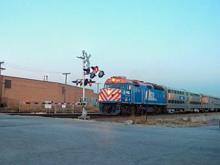 Westbound Metra commuter train at the North Kostner Avenue railroad crossing. Chicago Illinois. December 2006.