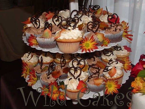 This photo is a closeup of a tall tier of wedding cupcakes for a fall