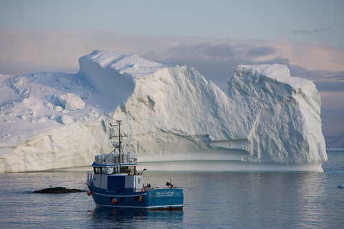 Fishing boat beside melting glaciers