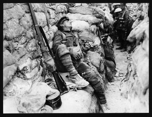 Soldiers comrades watching him as he sleeps, Thievpal, France, during World War I