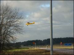 Yellow plane (sebilden) Tags: road cloud signs bird yellow plane fly airport wings sweden aeroplane landing descend airfield flaps pipercub sebel j3c65 sebilden