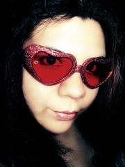 255 of 365 (Lady Pandacat) Tags: red portrait sunglasses glitter self wednesday shiny colorful heart mexican messyhair hispanic latina brunette 2008 sparkly fantabulous 365days pandacat iamnotamorningperson canona570is pandacatbaby tinaangel iwokeupat630amugh iforgottobrushmyhair yeahiknowimpale ladypandacatvonnopants