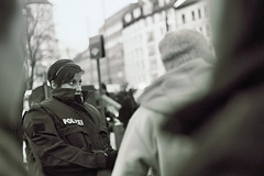 Polizistin (Matt Schley) Tags: germany munich münchen demo deutschland 50mm pentax k1000 kodak nazi nazis protest demonstration polizei gegen bw400cn pentaxm m5014