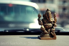 Ganpati_dof (Stuti ~) Tags: india field car canon out afternoon interior sunday lazy ganesh idol moved mumbai depth diety 400d