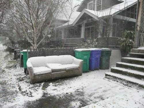 Snow on neighbors front yard sofa
