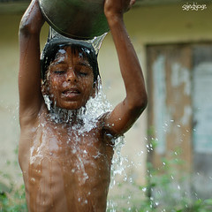 (sash/ slash) Tags: street boy wet water bucket bath child body bare kerala sash taking trivandrum sajesh aakkulam