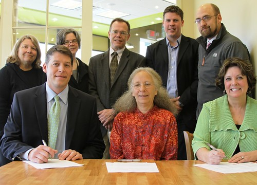 Colleen Landkamer, Minnesota State Director (Seated, Right) joins banking and community officials in signing funding documents for the St. Peter Food Co-op.