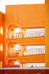 Spoiled by Desolation (Hankins) Tags: travel sunset vacation orange yellow architecture mexico bright playadelcarmen stairwell resort rivieramaya royalhaciendas