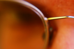 Glasses (basswulf) Tags: selfportrait blur macro eye metal lensbaby glasses lenstagged frames skin gimp spectacles 7days piel lensbaby20 wulf digitaldarkroom d40 7days6 camerasetting:aperture=f4 permissions:licence=c 200803 2700x1800 20080313