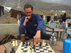 Pierre playing chess in Muktinath