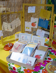 Chicken Wire Display (lauren-go-lightly) Tags: breakfast orlando community display handmade crafts arts gocco frenchtoast oranges fruity chickenwire craftfair notecards grandmaparty stardustcoffeeandfilm breakfastbunchhandmade