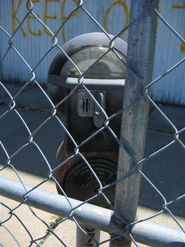 Time expired meter behind fence