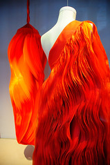 The red haute couture dresses (jmvnoos in Paris) Tags: red paris france window fashion shop rouge nikon dress robe dresses boutique 100views shops 400views 300views 200views fold 500views hautecouture mode soe folds 600views vitrine pli 1000views robes d300 boutiques plis mywinners colorphotoaward jmvnoos