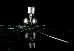 Revenge (jæms) Tags: light black topf25 bulb studio smash globe destruction explore surprise damage soundtrigger hiviz remoteflash remoteshutter strobist