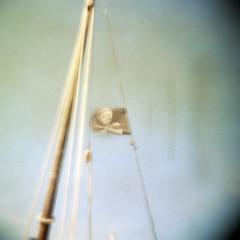 Jolly Roger (_cassia_) Tags: blue summer blur 120 june st mediumformat square boat holga cornwall flag mast ives jollyroger skullandcrossbones