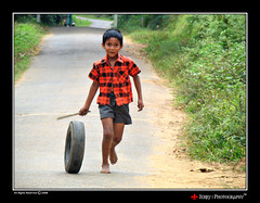 Lets Ride (| JERRY |) Tags: india joseph kid jerry kerala wayanad southindia letsride sonyh9 sonydsch9 dsch9 jerryclicks jerryphotography wwwjerrysworldin boyridingatyre kidplayingwithatyre