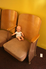 Day 113: The Baby and the Business Card (quinn.anya) Tags: baby chair doll seat dirty businesscard day113 525600minutes 2010yip