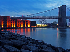 extending oneself (nj dodge) Tags: nyc newyorkcity blue orange water brooklyn lights rat rocks listeningto dumbo brooklynbridge eastriver jonimitchell brooklynbridgepark chalkmarkinarainstorm
