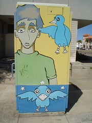 Blue bird poking fun at depressed art guy
