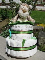 The Cheetah's the Cherry Baby Cake (Diaper Cake / Nappy Cake) (2 tiers) - View 1 (FearnyDesigns) Tags: uk two england baby brown colour cute green cakes nature cake nappy diaper gifts cheetah ribbon diapers eco unisex nappies babyshower tier ecofriendly environmentally diapercake biodegradeable babycare babycake nappycake fearnydesigns