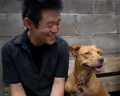 a man and his dog (mizmareck) Tags: dog smile happy sienna bbq pitbull fourthofjuly independenceday phillipckim july42008 flickr:user=phillipckim