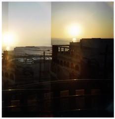 Double Exposure, Casablanca (Timothy Slessor) Tags: ocean africa sunset sky beach architecture night lomo doubleexposure atlantic morocco diana casablanca