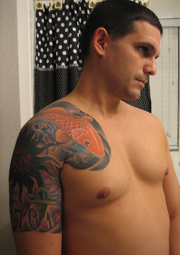 Half Sleeve Tattoo Koi Fish Finished in orange color