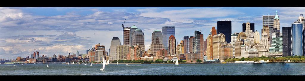 Liberty Island Ferry Panorama shot of NYC Citscape