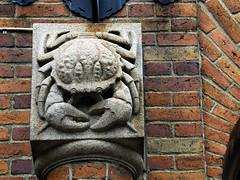 Stone crab (Eva the Weaver) Tags: door sculpture brick stone wall gteborg sweden gothenburg crab relief sculpted sjbeflsskolan