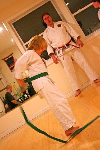 Putting on his green belt