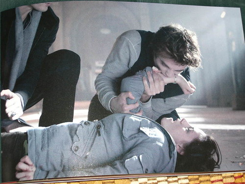 The Twilight movie screenshot: Edward saving Bella (sucking venom out) by Billie Joe's Entourage.