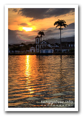 Paraty, Brasil (Tony Glvez) Tags: sunset sea brazil orange mist mountain reflection church water colors fog brasil riodejaneiro paraty canon cores geotagged atardecer mar agua holidays colours laranja iglesia parati colores canoneos20d igreja palmtree reflejo puestadesol montaa naranja canoneos reflexo palmera vacaciones niebla montanha ferias palmeira tropicalrainforest costaverde mataatlantica mataatlntica rodejaneiro geolocated atlanticrainforest bosquetropical geolocalizada geoetiquetada geoposicionada bosqueatlntico geopositioned