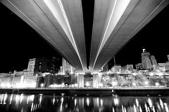 Under Wabasha Street Bridge, Night (2) (St Paul Paul) Tags: city bridge urban blackandwhite bw reflection minnesota night river mississippi lights cityscape stpaul twincities saintpaul wabasha damniwishidtakenthat